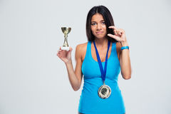 Sports success woman with medal Royalty Free Stock Images
