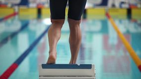 Sports swimming start jumping into the water. Start position race with one swimmer on swimming pool with sound stock video footage