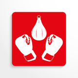 Sports symbols. Boxing. Vector icon. Red and white image on a light background with a shadow. Royalty Free Stock Photography