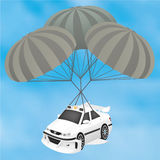 Sports Taxi Planning on a Parachute. Sports White Taxi made in the style of the cult film of the same name. The scene with the landing of the aircraft Royalty Free Stock Photography