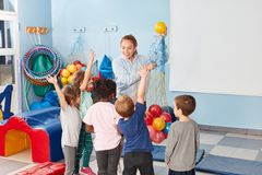 Sports teacher and children in the gym stock photo