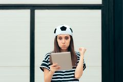Soccer Female Fan Checking Football Match on PC Tablet Royalty Free Stock Photo