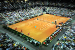 Sports tennis arena with public in a dynamic motion Royalty Free Stock Photography