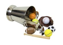 Sports time. Silver bucket full of sports equipment to satisfy everyone's desires - path included Stock Photography