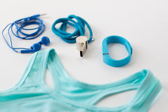 Sports top, fitness tracker, earphones and whistle Royalty Free Stock Images