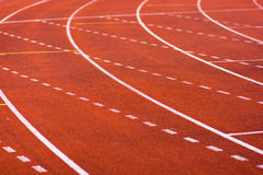 Sports tracks. On red field Royalty Free Stock Photo