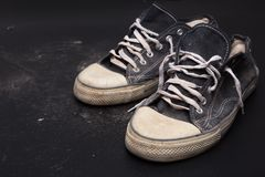 Sports trainers on the floor. Old sports trainers on the floor Royalty Free Stock Photography