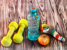 Maintain your fitness with food, drink, sports equipment. stock image