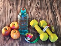 Sports training at home - food, drink, sports equipment royalty free stock photos