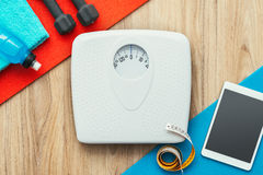 Sports and training. Weight scale, digital tablet and sports training equipment on a table, weight loss and healthy lifestyle concept, flat lay Royalty Free Stock Photos