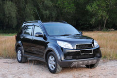 Sports utility vehicle. Suv at offroads in a natural terrain Stock Photography