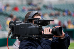 Sports Video. A professional videographer at a baseball game Stock Photo