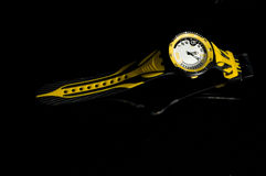 Sports watch. Yellow and black sports watch reflected on black background Royalty Free Stock Photo