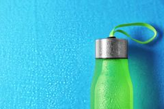 Sports water bottle on color background. Space for text royalty free stock photo