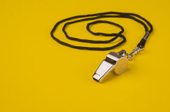 Sports Whistle. Coaches chrome sports whistle on a rope Stock Images