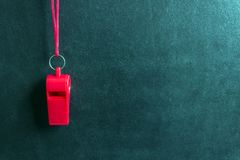 Sports whistle on a red lace.Concept- sport competition, referee, statistics, challenge, friendly match. Copy space stock photography