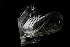 Sports winter boots on black Royalty Free Stock Images