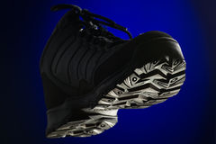 Sports winter boots on blue background Stock Photos