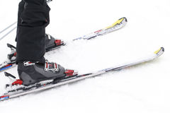 Sports, winter, skier. A foot closeup skier, winter sports background Stock Photos