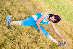 Sports Woman. Sports young woman Stretches outdoors royalty free stock photography