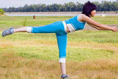 Sports woman. Sports active woman doing exercise outdoors in nature Royalty Free Stock Image