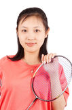 Sports woman. Asian woman holding a badminton racket, isolated on white Royalty Free Stock Photo