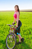 Sports woman with bike Royalty Free Stock Photo