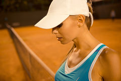Sports woman in cap Royalty Free Stock Images