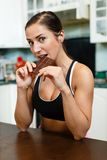 Sports woman with chocolate. Stock Photo