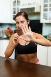 Sports woman with chocolate. Royalty Free Stock Images