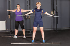 Sports woman crossfit barbell training with plastic bar Royalty Free Stock Images
