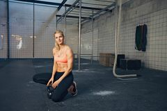 Sports woman at crossfit gym with kettlebell Stock Photography