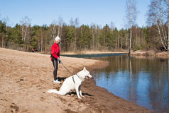 Sports woman with a dog Royalty Free Stock Photo