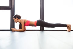 Sports woman doing plank exercise Stock Images