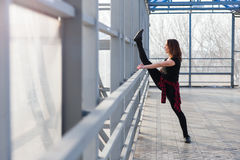 Sports woman doing stretching outdoors Stock Photos
