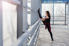 Sports woman doing stretching outdoors Stock Photo