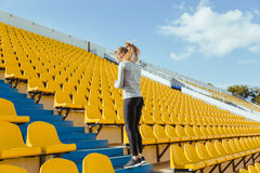 Sports woman doing warm up exercises Stock Images