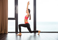 Sports woman doing yoga exercises in fitness gym Stock Photography