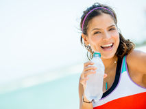 Sports woman drinking water Stock Image