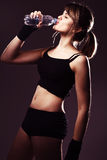 Sports woman drinks water Royalty Free Stock Images