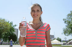 Sports woman drinks water Stock Photos