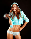 Sports woman with dumbbell smiling on camera Stock Photography