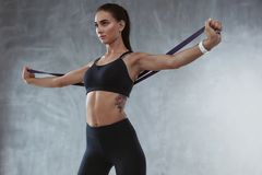 Sports Woman In Fashion Sportswear Exercising With Elastic Band Royalty Free Stock Images