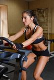 Sports woman in the gym. Royalty Free Stock Photos