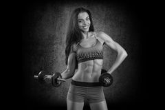 Sports. Woman at the gym doing stretching exercises and smiling Royalty Free Stock Photo