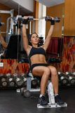 Sports woman in the gym. Royalty Free Stock Photography