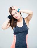 Sports woman having headache Stock Photo