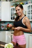 Sports woman and healthy food. Royalty Free Stock Image