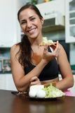Sports woman and healthy food. Royalty Free Stock Images
