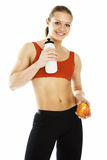 Sports woman holding an apple and bottle of water Stock Images